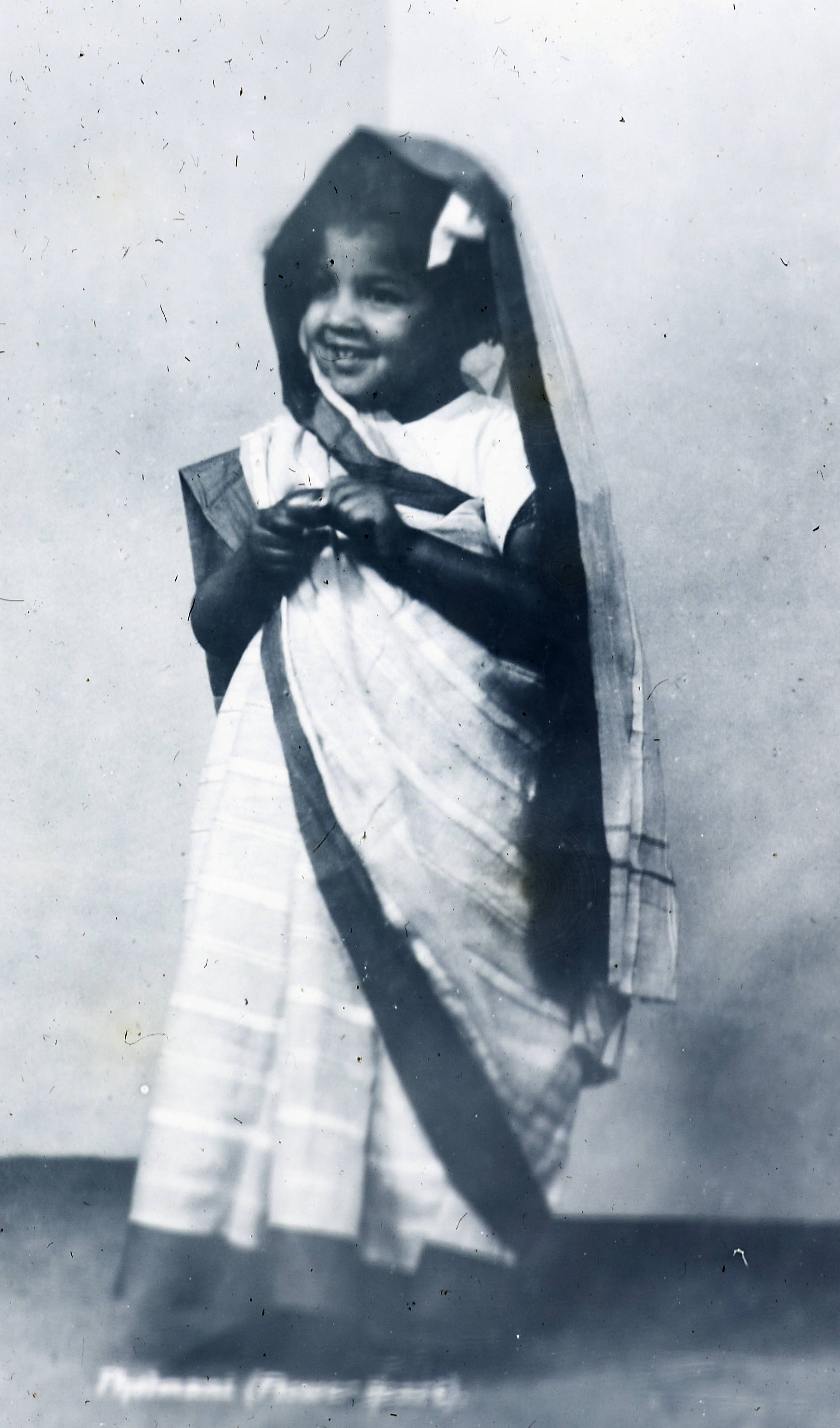 While still extremely young, a little girl still wears a blouse with her sari
