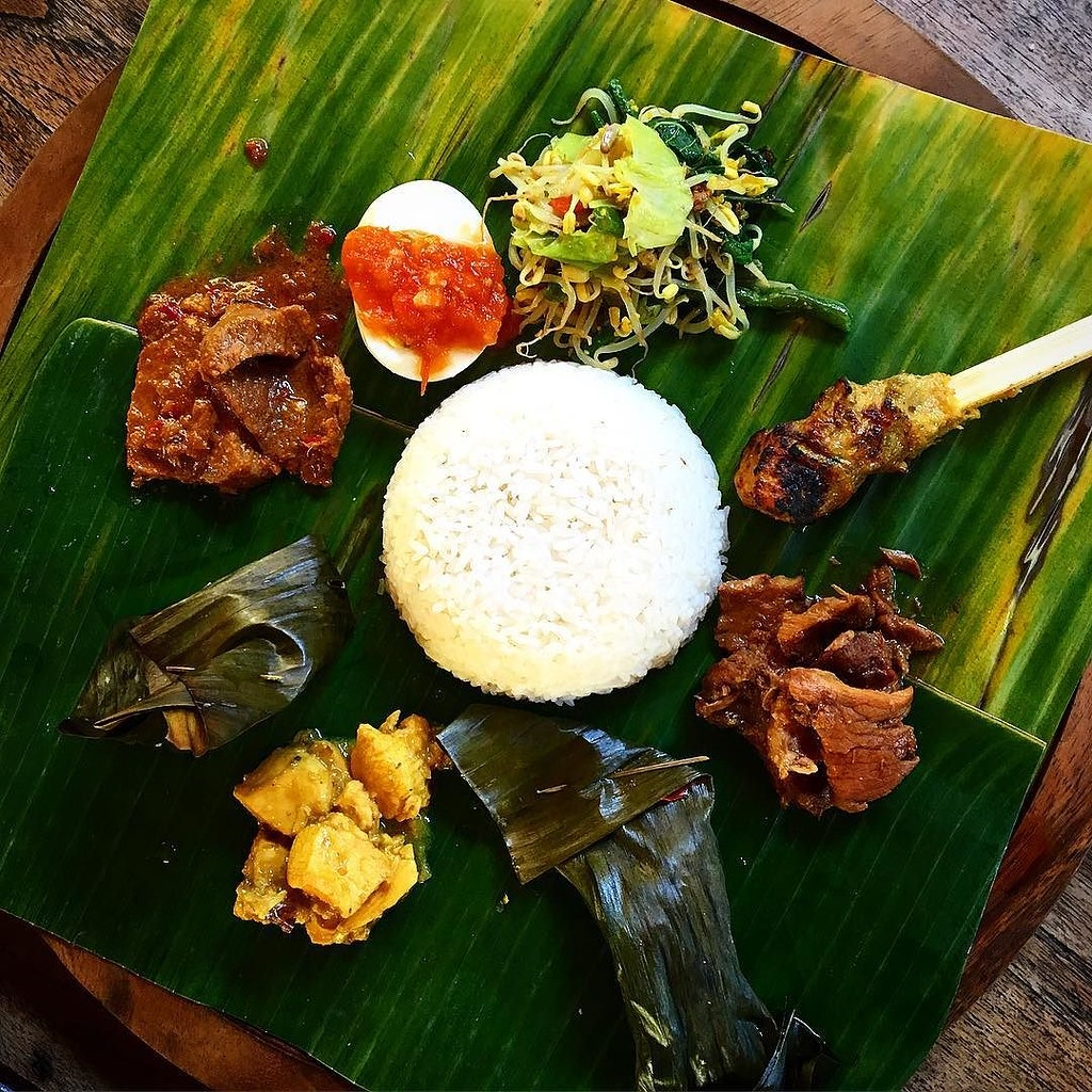 Delicious traditional Balinese food served on a leaf plate