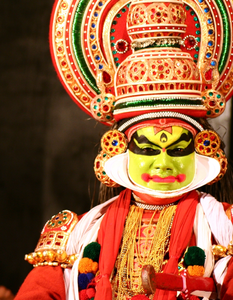 A Kathakali performer in full costume and extravagant makeup