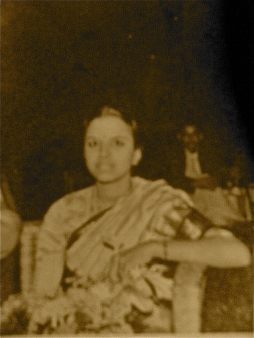 An old picture of an Indian grandmother, in India, now living in a foreign country to be closer to her kids and grandkids.