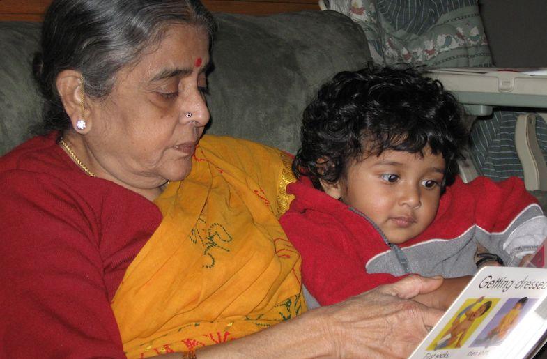Amma reading to Medha (Image by Author)
