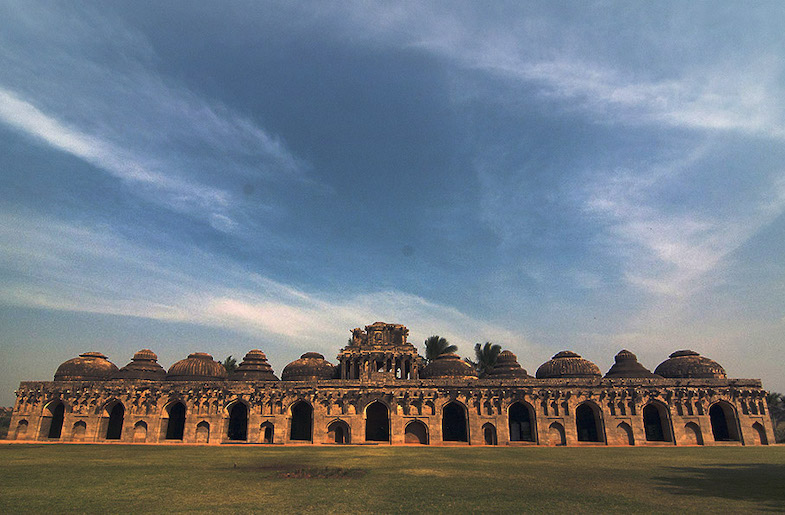 The Elephant Stable with its homogenous group of chambers, high arched facade and lofty domed roof is one of the masterpieces of Hampi's Indo-Islamic architecture.