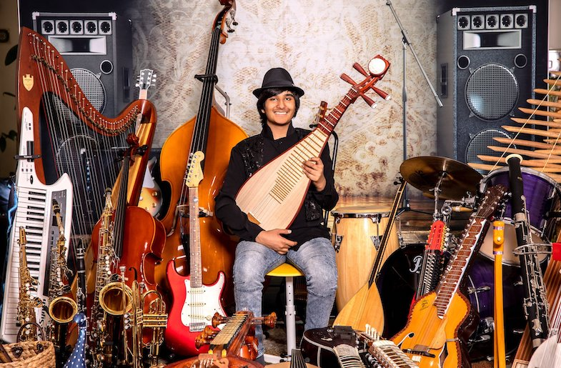 Neil Nayyar with the many instruments he can play.